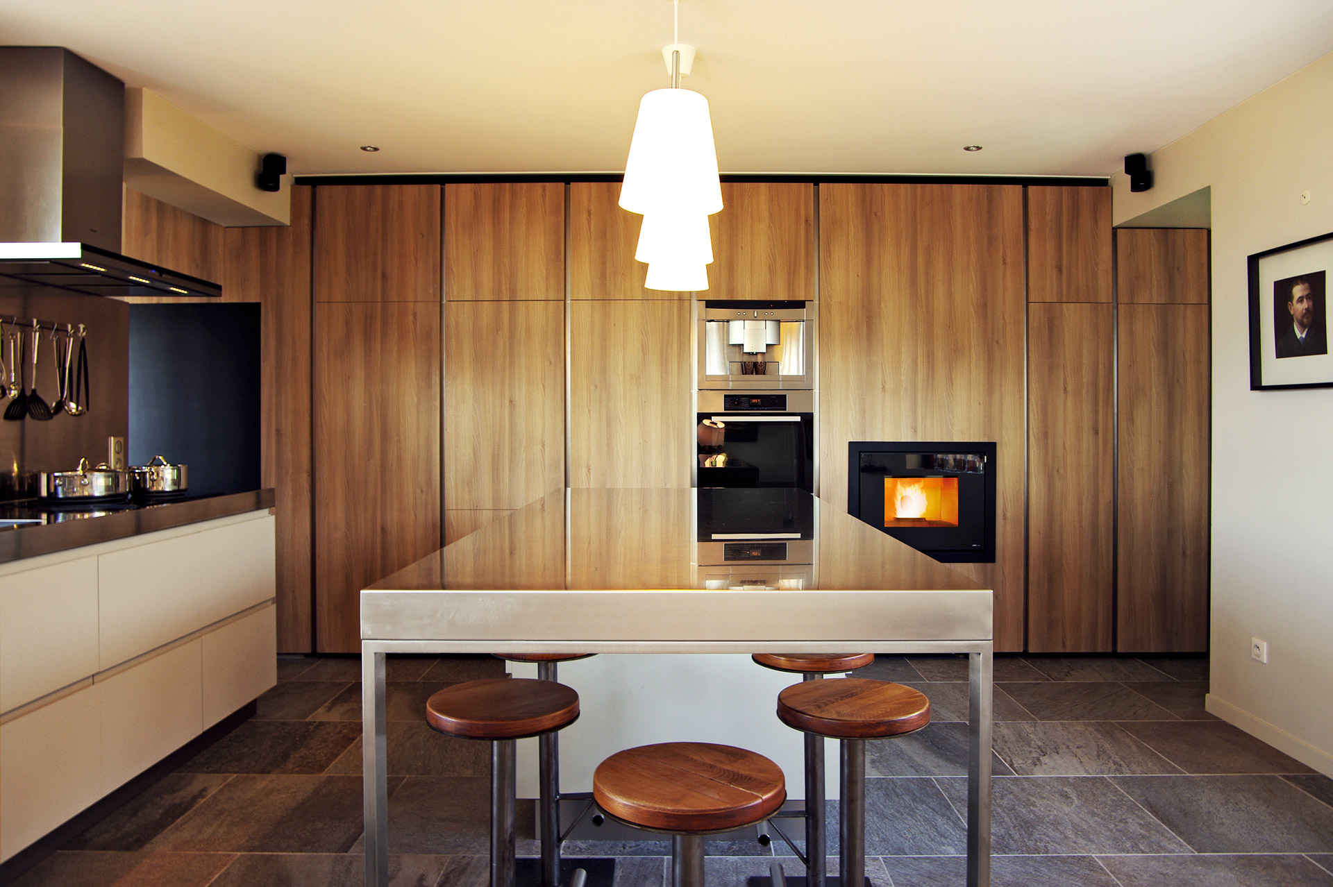 Pellet fireplace in a kitchen by MCZ
