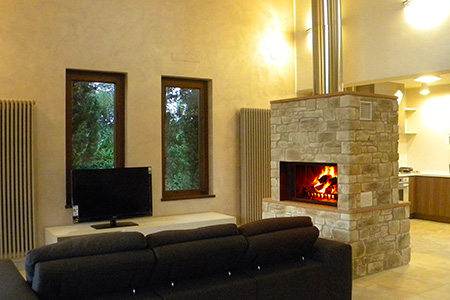 Steel and stone wood fireplace by MCZ