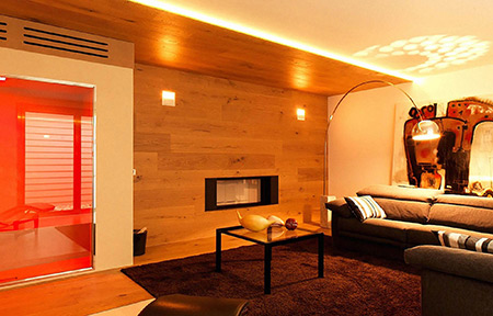 Wood fireplace in sauna by MCZ